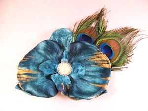 Turquoise orchid with peacock feathers
